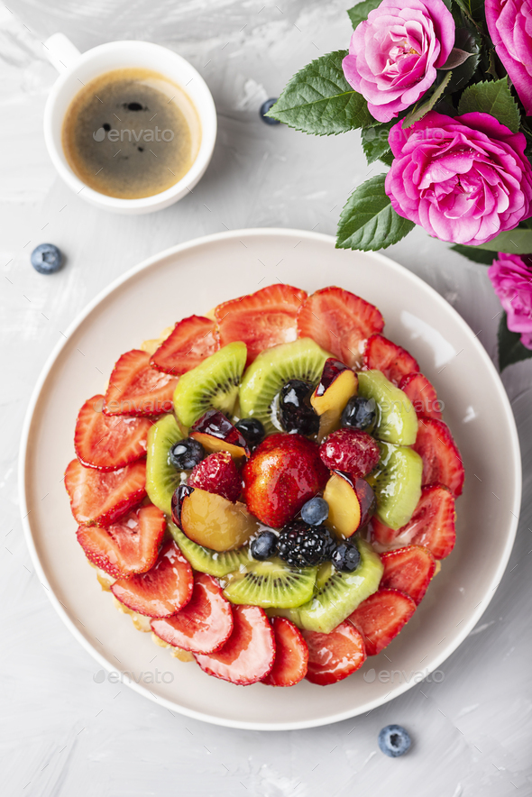 Tart with strawberries, kiwi, plums and cream - Stock Photo - Images