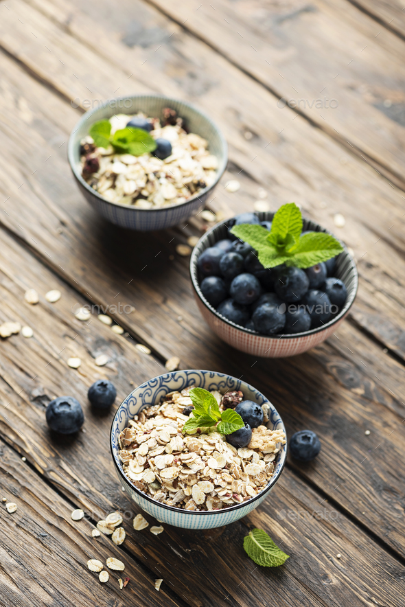 Mix of homemade cereal with blueberry and mint - Stock Photo - Images