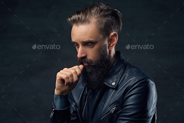 Thoughtful bearded male in a black leather jacket. - Stock Photo - Images