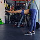 Slim female exercising with trx suspension strips in a gym club. - PhotoDune Item for Sale