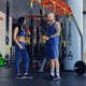 Athletic male and female posing near trx straps stands. - PhotoDune Item for Sale