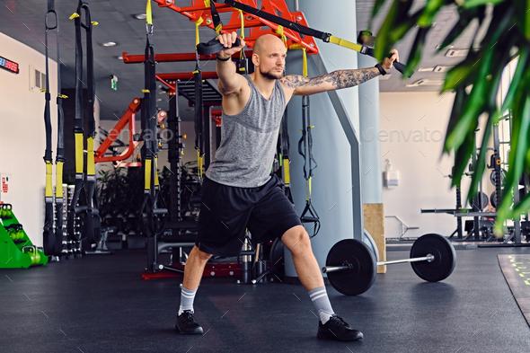 A man doing trx straps exercises - Stock Photo - Images