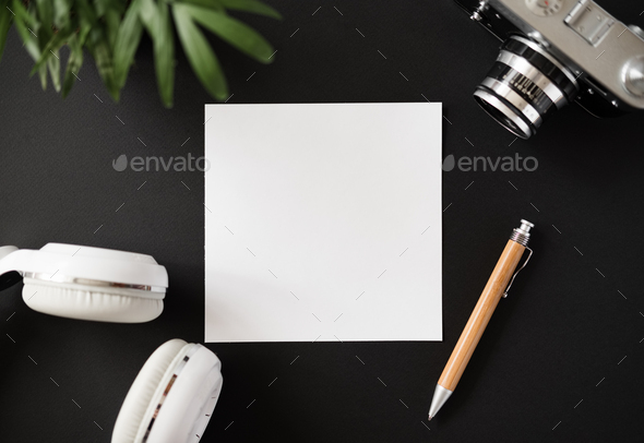 Top view of a flat lay blank paper pen earphones - Stock Photo - Images