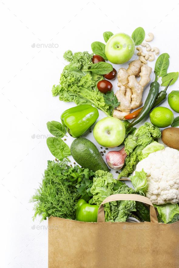 Healthy green vegan vegetarian food in full paper bag - Stock Photo - Images