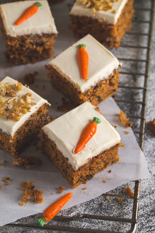 pieces of carrot cake with walnuts with icing cream - Stock Photo - Images