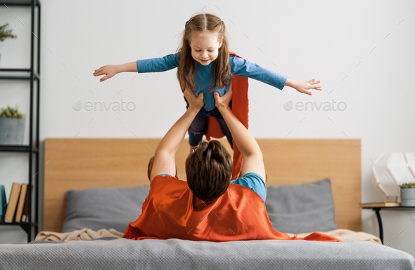 Girl and daddy in Superhero costume - Stock Photo - Images