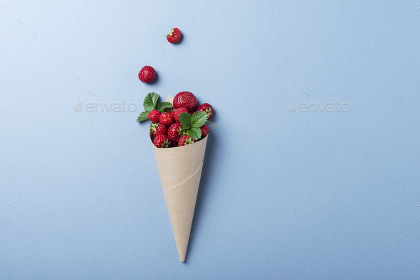 Sweet fresh strawberry into paper cone - Stock Photo - Images