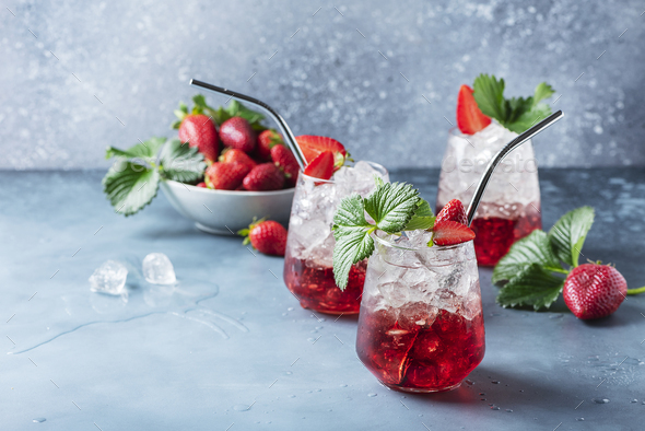 Red cocktail with ice and fresh strawberry - Stock Photo - Images