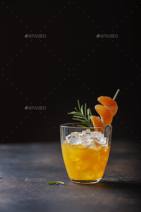 Alcoholic cocktail with mandarins - Stock Photo - Images