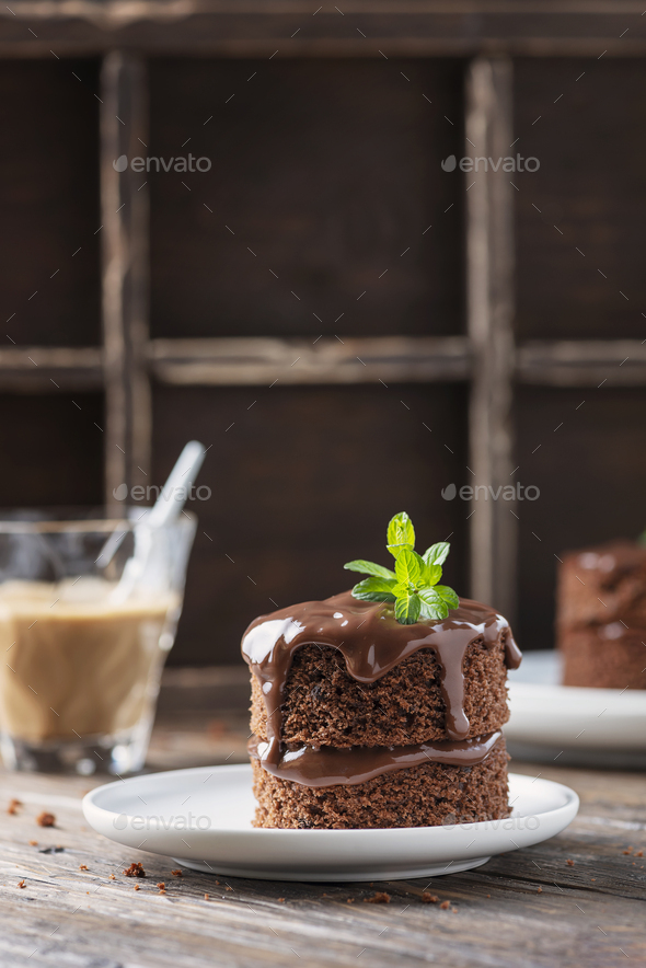 Chocolate mini cake on the wooden table - Stock Photo - Images
