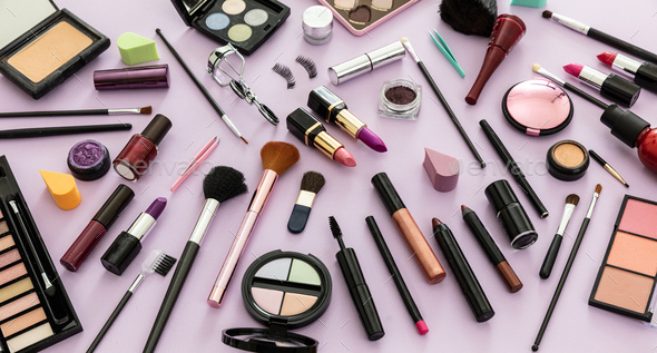 Make up cosmetics products against pastel purple background, - Stock Photo - Images