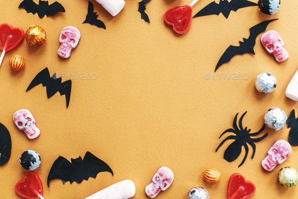 Halloween frame flat lay on orange paper - Stock Photo - Images