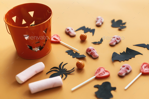Halloween Jack o Lantern, bucket with holiday candy - Stock Photo - Images