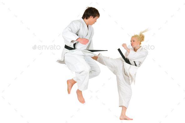 Cute blonde girl and a young cheeky guy karate - Stock Photo - Images