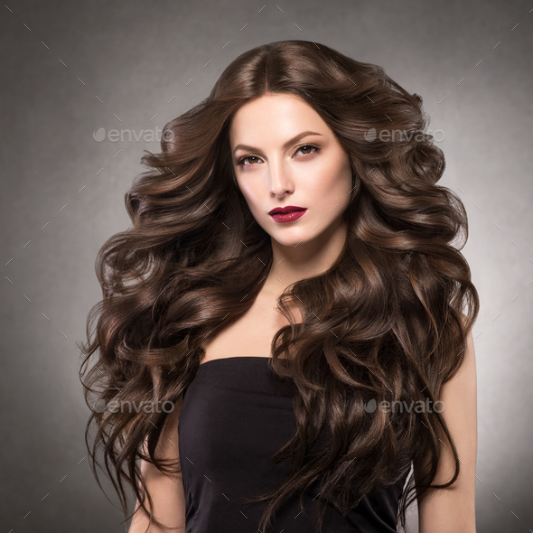 Long curly hairstyle woman beauty fashion red lips make woman - Stock Photo - Images