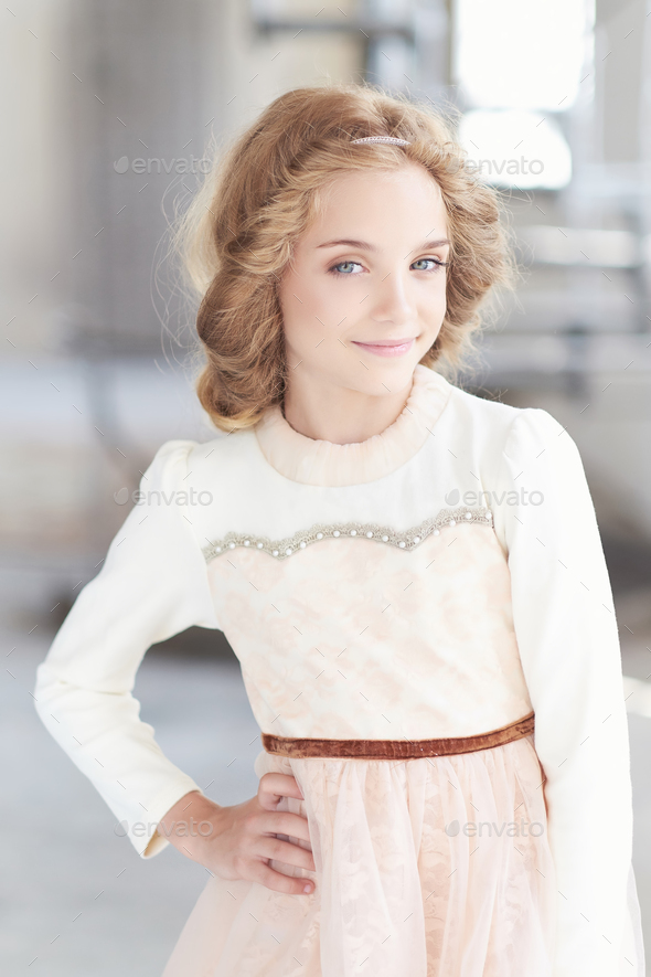 Portrait of cute blue eyes teenager girl. - Stock Photo - Images