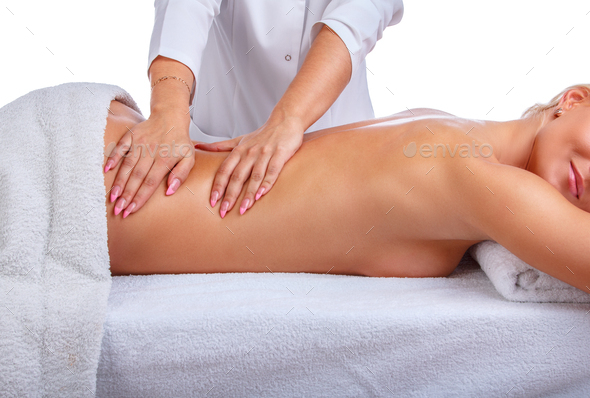 Female enjoing relaxing back massage. - Stock Photo - Images