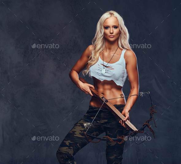 A woman holds crossbow. - Stock Photo - Images