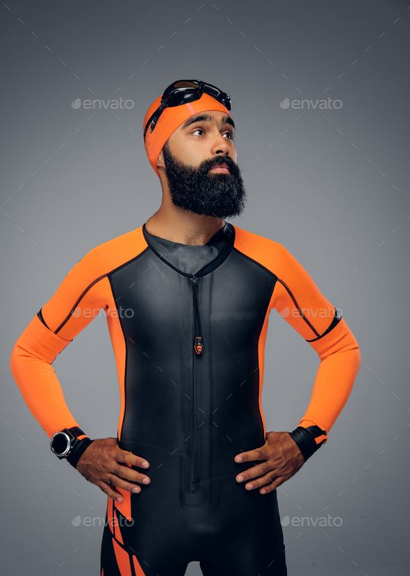 Male in scuba diving mask and orange neopren diving suit. - Stock Photo - Images