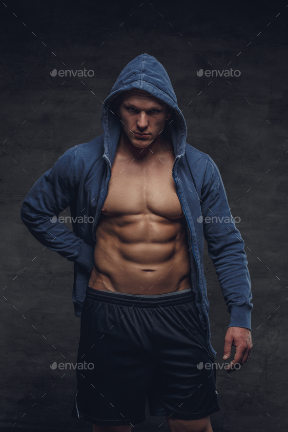 Abdiminal man in a blue hoodie. - Stock Photo - Images