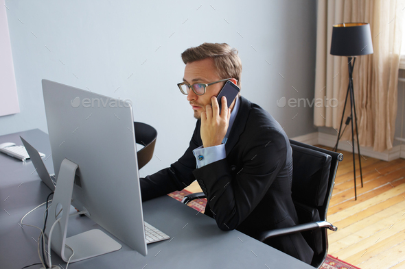 Young business man in office. - Stock Photo - Images