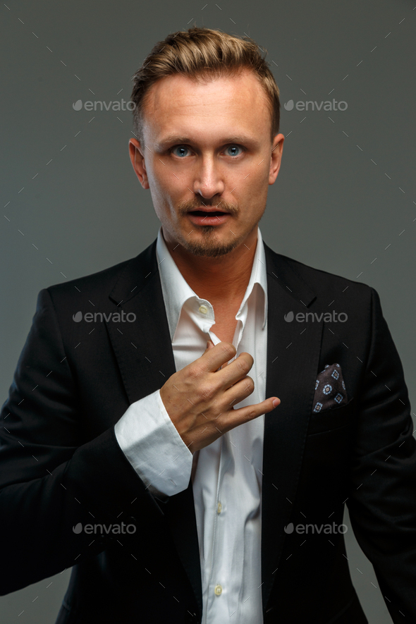 Portrait of a man in a suit. - Stock Photo - Images