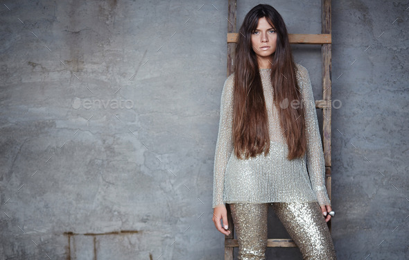 Fashionable woman with long brown hair. - Stock Photo - Images