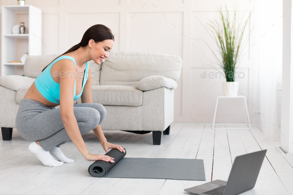 Fit Woman With Rolling Mat Preparing For Training At Home - Stock Photo - Images