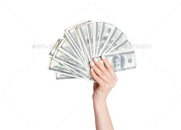 Wealth concept. Female hand holding large fan of dollars on white background, closeup - Stock Photo - Images