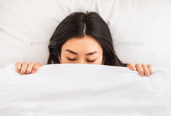 Korean Girl Sleeping Covered With Blanket In Bed Indoor, Top-View - Stock Photo - Images