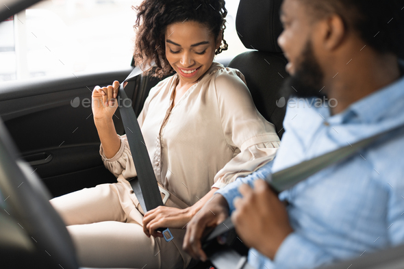 Spouses Sitting In Car Putting On Seat Belts In Dealership - Stock Photo - Images