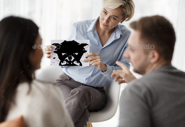 Psychologist Testing Couple Showing Inkblot Picture Sitting In Office - Stock Photo - Images