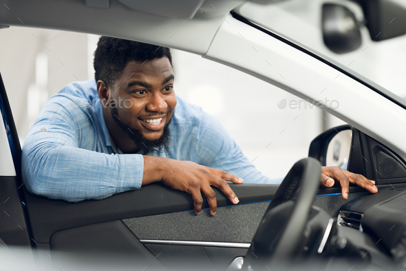 Man Buying Car Looking At Vehicle Interior In Dealership Center - Stock Photo - Images