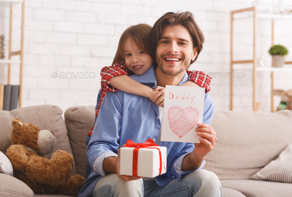 Happy dad and his little daughter celebrating Father Day - Stock Photo - Images