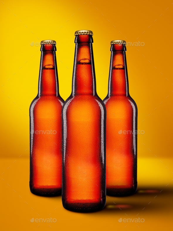Beer bottles with long neck on yellow background mockup - Stock Photo - Images