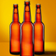 Beer bottles with long neck on yellow background mockup - PhotoDune Item for Sale