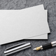 Mockup of business card with fountain pen at black slate background - PhotoDune Item for Sale