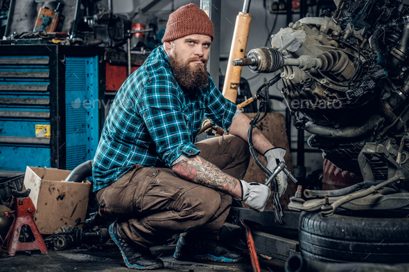 Mechanic man in a garage. - Stock Photo - Images