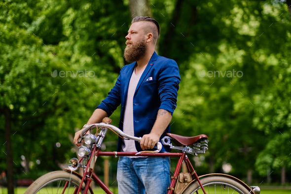 Image of a man on a retro bicycle. - Stock Photo - Images