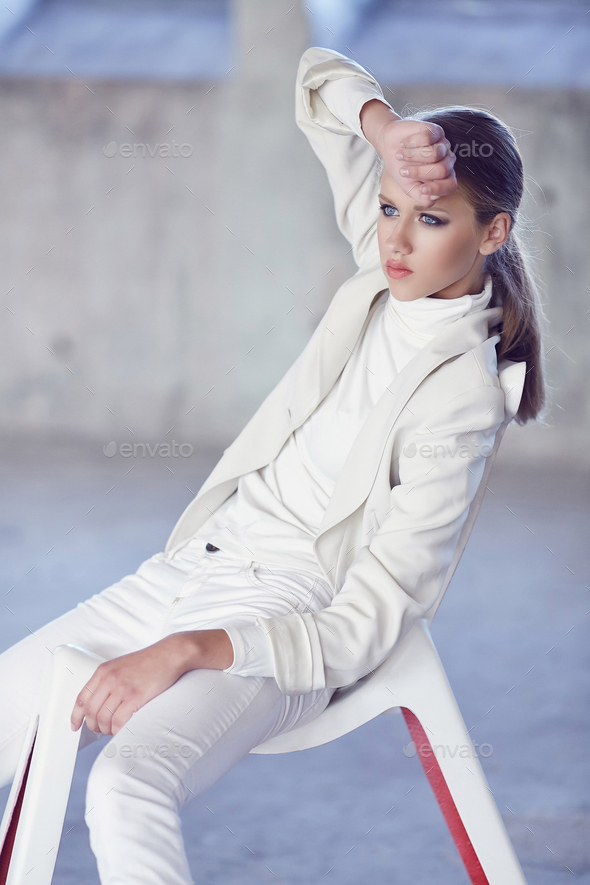 Blue eyes young woman in a white clothes. - Stock Photo - Images