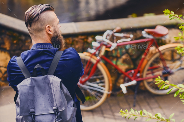 Casual modern guy with backpack. Back view. - Stock Photo - Images