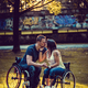 Handicapped young couple on two wheelchairs kissing . - PhotoDune Item for Sale