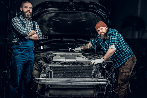 Two men in a garage. - Stock Photo - Images