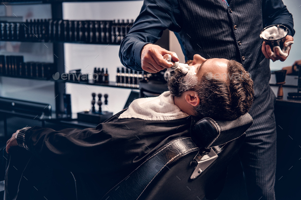 Barber applies shaving foam - Stock Photo - Images