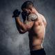 Fighter male over grey vignette background. - PhotoDune Item for Sale