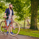 Redhead bearded male on a retro bicycle in a park. - PhotoDune Item for Sale
