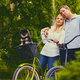 Blond woman and a man on a bicycle ride in a park. - PhotoDune Item for Sale