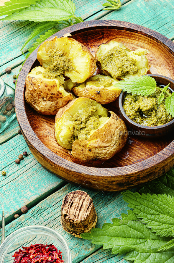 Home baked potato with greens. - Stock Photo - Images