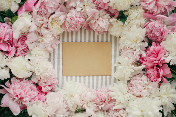 Greeting card template in peonies frame flat lay on rustic table cloth - Stock Photo - Images