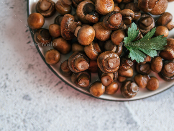 Fried mini champignons on plate, copy space - Stock Photo - Images